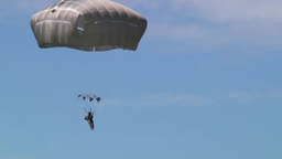 Supporting D-Day Anniversary parachuting from C-130 Hercules Stock Video Footage