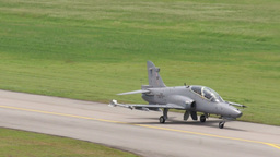 BAE Hawk Military Fighter Jets take off and land Stock Video Footage