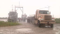 Petrol tanker Vehicle offload of a Landing Craft Utility Stock Video Footage