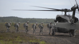 173rd Airborne Brigade UH-60 helicopter parachute Jump Stock Video Footage