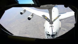 KC-135 stratotanker 340th EARS refuels E-3 over Afghanistan Stock Video Footage