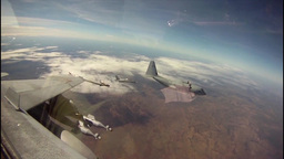 KC-130 aircraft refueling F/A-18 jets mid-air cockpit... Stock Video Footage