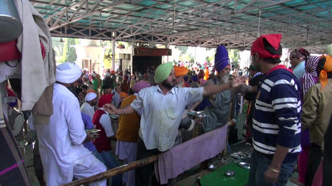 many sikh pilgrims volunteers washing dishes in Amritsar Golden temple after eat Footage