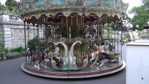 people in Paris old town vintage carousel. MAY 25, 2014 in Paris, France Footage