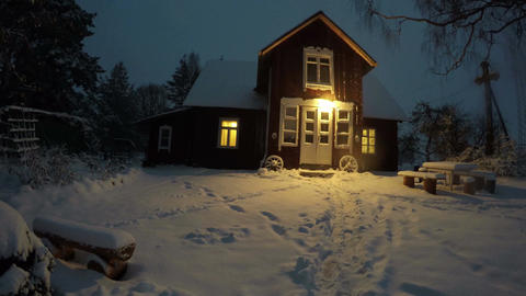 Wooden house in winter evening, time lapse 4K Footage