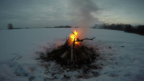 Bonfire burning in winter field, 4K Footage