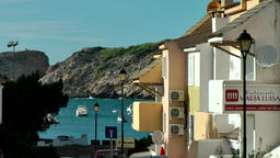 Europe Spain Balearic Ibiza towns and villages 111 slope street in Cala Vedella Footage