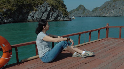 A woman admires the beautiful views of Halong Bay Footage