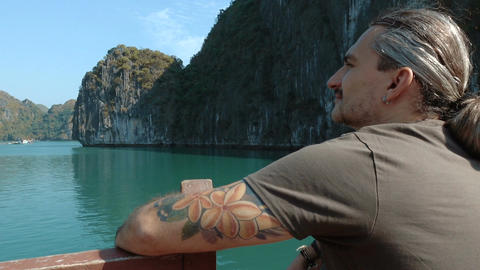 Man admires the beautiful views of Halong Bay Footage