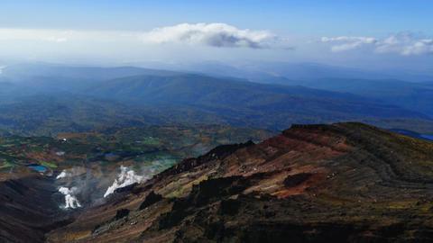 Beautiful vistas from the top of Mountain Asahidake. / time lapse pan Footage