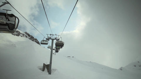 View of ski lifts construction at snowy mountains. Ski resort. Snowboarding. Ope Footage