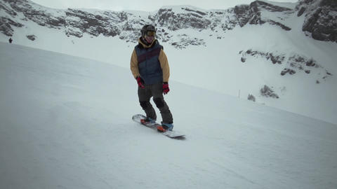 Snowboarder ride on slope make ollies stunt at snowy mountain. Contest. Challeng Footage