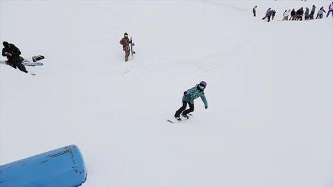 Snowboarder jump on trampoline in snowy mountain. Tricks. Contest. Challenge. Pe Footage