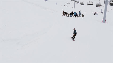 Snowboarder jump on springboard in snowy mountain. Stunts. Contest. Challenge. P Footage