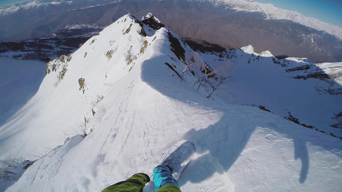 Snowboarder backcountry ride from top of snowy mountain. Dangerous. Extreme. Go  Footage