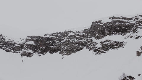 Panoramic view of snowy mountains peaks. Grey weather. Nature. Landscape. Scener Footage