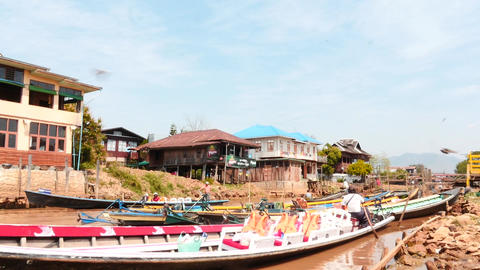 Fishers boats at piers near Inle lake in Myanmar time lapse Footage