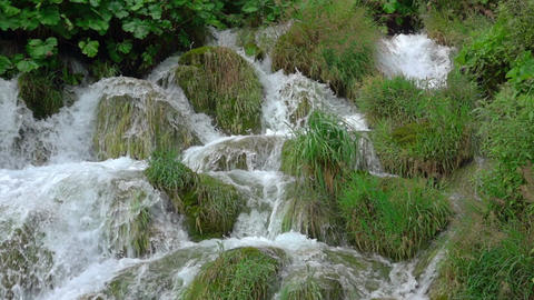 Green Grass and a Waterfall. Slow Motion Footage