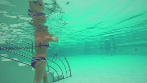 Girl Walks Out Of Indoor Pool Filmmaterial