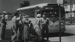 4K USA 1950s: People Waiting at Bus Stop Board Bus Footage
