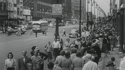 4K USA 1950s: Sidewalks Crowded with Pedestrians in Big City Street Scene Footage