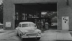 USA 1950s: Car Exits Carwash Filmmaterial