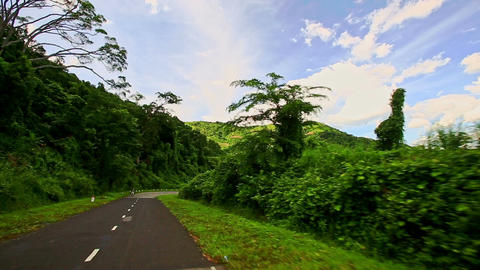 Motion along Country Curvy Road among Hilly Landscape under Sky Live Action