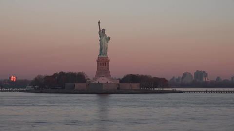 View of the Statue of Liberty and Ellis Island in sunset sunrise, New York State Footage