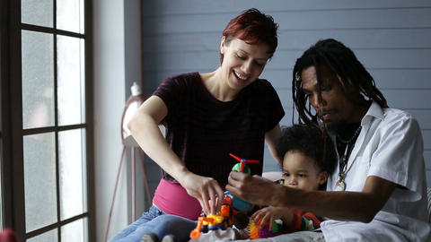 Smiling interracial family enjoying time together Footage