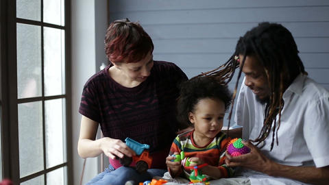 Smiling mixed race family playing with toys Footage