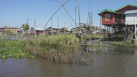 Stilted houses in village and boats on Inle Lake Footage