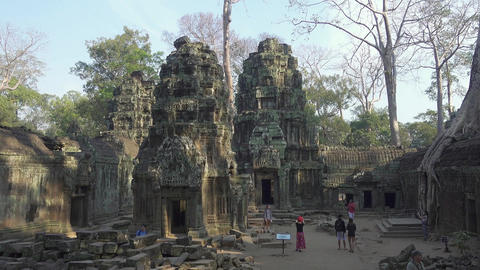 Tourists in Ta Prohm temple in Angkor Wat Footage