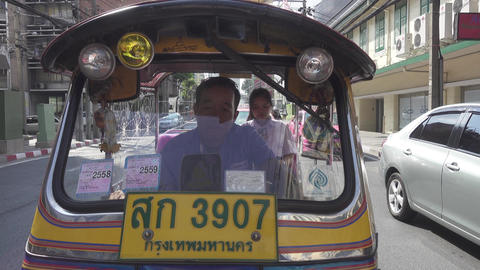 Tuk-tuk taxi on the street of Bangkok Footage