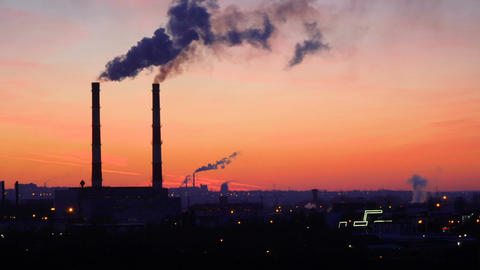 timelapse video of oil refinery and air pollution at sunset ビデオ