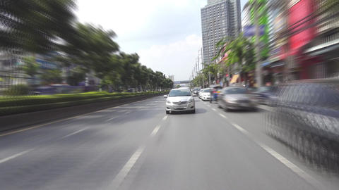 Cars, taxi and tuk-tuk on the streets of Bangkok Footage