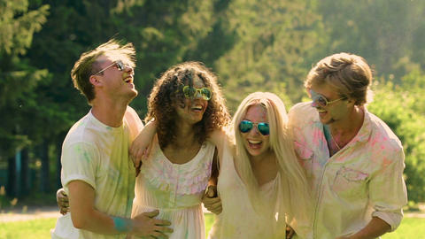 Multiethnic friends hugging and laughing, having fun at summer holiday festival Footage
