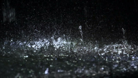 Water drops falling on ground, energy and freshness, illuminated fountain Footage