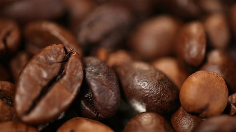 Aromatic roasted coffee beans lying on sack, energy boosting morning drink Footage