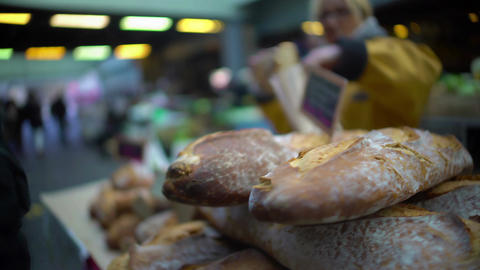 Male customer buying freshly baked bread at market, healthy lifestyle and food Footage