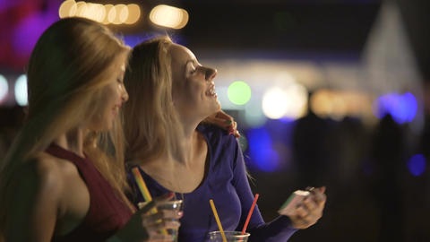 Pretty female friends posing for selfie with cocktails, admiring self-portraits Footage