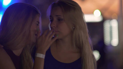 Emotional young woman crying after breakup, supportive female friend hugging her Live Action