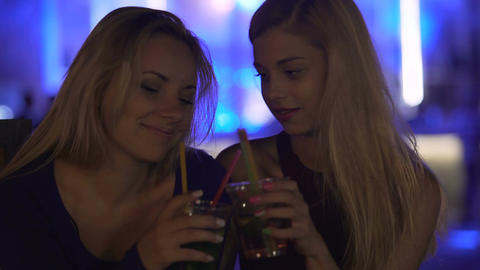 Beautiful woman buying cocktail to support depressed best friend, togetherness Footage
