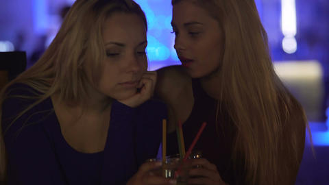 Pretty female talking to upset disappointed friend at party, supportive person Live Action