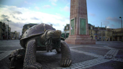 Bronze sculpture of turtle standing on Place de la Victorie in Bordeaux, France Footage