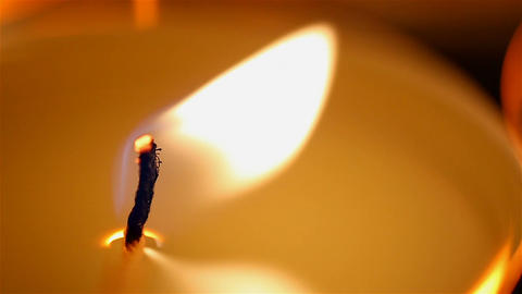Fire of life, burning candle close-up, mysterious candlelight in dark place Footage