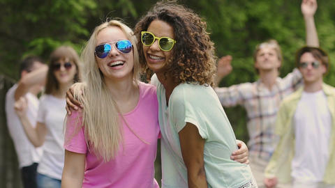 Energetic youth enjoying party in park, summer activities, dancing outdoors Live Action
