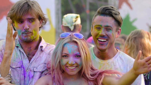 Crazy young people dancing and having fun at Holi festival, cool open-air party Footage
