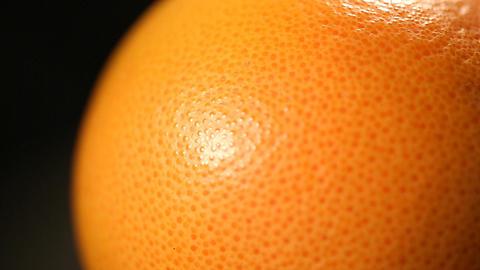 Citrus fruit closeup, orange peel cellulite problem treatment, unhealthy skin Live Action