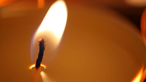 Candle flame affected by strong wind, facing problems,... Stock Video Footage