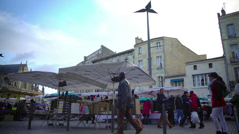 Local market near ancient Bordeaux cathedral in France, urban life, tourism Footage